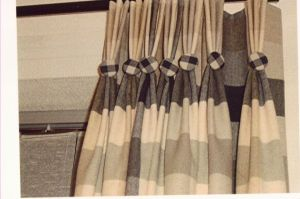 Pinch pleat curtain with button detail